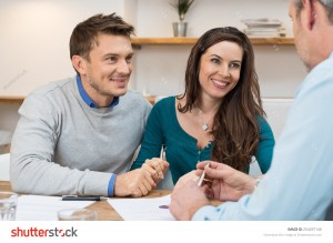 stock-photo-young-couple-meeting-financial-advisor-for-investment-254297140